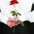 Man holding rose close-up — Stock Photo #13542427