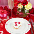 Table setting in honor of Valentine's Day on white fabric background - Stock Photo