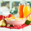 Tasty dieting food and bottles of juice, on wooden table — Foto Stock