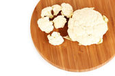 Fresh cauliflower on wooden board isolated on white — Stock Photo