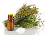 Bottle of medicines with herbs on white background. concept of homeopathy — Stock Photo