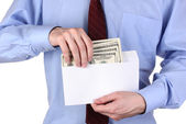 Man gets out of the envelope dollars on white background close-up — Stock Photo