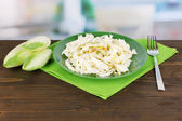 Plate with coleslaw and chicory on wooden table on room background — Stock Photo