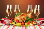 Banquet table with roast chicken on brown background close-up. Thanksgiving — Stock Photo