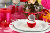 Ring in gift box on celebratory table of Valentine — Stockfoto