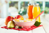 Tasty dieting food and bottles of juice, on wooden table — Stock Photo