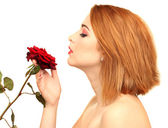 Portrait of sexy young woman with red rose — Stock Photo