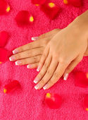 Woman's hands on bright pink terry towel, close-up — Stock Photo