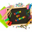 Small chalkboard with school supplies on white background. Back to School - Foto Stock