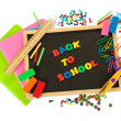 Small chalkboard with school supplies on white background. Back to School -  