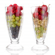 Mixed fruits and berries in glasses isolated on white — Stock Photo #13579942
