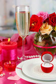 Ring in gift box on celebratory table of Valentine's Day on room backgroun — Stock Photo