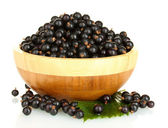 Fresh black currant in wooden bowl isolated on white — Stock Photo