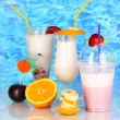 Royalty-Free Stock Photo: Delicious milk shakes with fruit on blue sea background