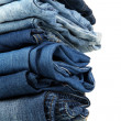 Stock Photo: Lot of different blue jeans close-up isolated on white