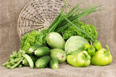 Fresh green vegetables on sackcloth background — Стоковое фото