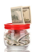 Clear glass jar for tips with money isolated on white — Stock Photo