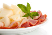 Parma ham and melon, isolated on white — Stock Photo