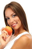 Beautiful young woman with peach, isolated on white — Stock fotografie