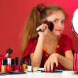 Little girl in her mother's dress with make up brushes — Stock Photo