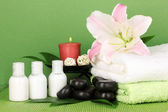 Beautiful spa setting on green background — Stock Photo