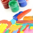 Jars with colorful gouache with a bright picture close-up - Photo