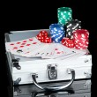 Stock Photo: Poker set on metallic case isolated on black background