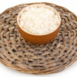 Stock Photo: bowl of rice on wicker mat isoalted on white