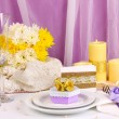 Serving fabulous wedding table in purple and yellow color on white and purp - Stock Photo
