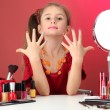 Little girl in her mother's dress, is trying painting her nails — Stockfoto #13649548