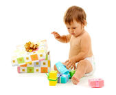 Cute baby and gift box isolated on white — Stock Photo