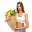 Beautiful young woman with vegetables and fruits in shopping bag , isolated — Stock Photo #13650246