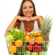 Stock Photo: Beautiful young woman with fruits and vegetables in shopping basket, isolat