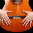 Guitar in hands isolated on black - 