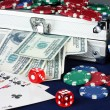 Stock Photo: Suitcase with dollars on the blue poker table