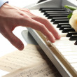 Hand of man playing piano — Stock Photo