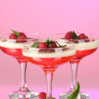 Fruit jelly with berries in glasses on pink background - Stock Photo