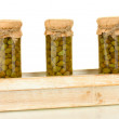 Stock Photo: Glass jar with tinned capers isolated on white