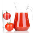 Tomato juice in pitcher isolated on white - Stock Photo