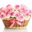 Beautiful bouquet of pink roses in basket, isolated on white — Stock Photo