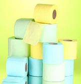 Bright rolls of toilet paper on green background — Stock Photo