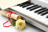 Background of synthesizer keyboard with flower — Stock Photo