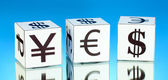 Forex. currency in the white dices on blue background — Stock Photo