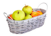 Ripe apples in basket isolated on white — Stock Photo