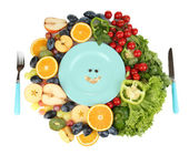 Blue plate surrounded by wholesome food diet isolated on white — Stock Photo