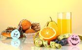 Useful and harmful food on yellow background — Stock Photo