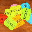Royalty-Free Stock Photo: Colorful tickets on wooden background close-up