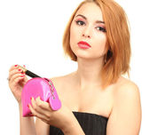 Beautiful young woman with mascara in cosmetics bag — Stock Photo