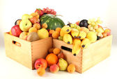 Still life of fruit in a boxes isolated on white — Stock Photo