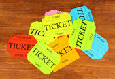 Colorful tickets on wooden background close-up — Stock Photo